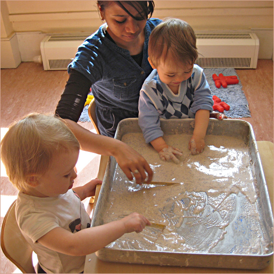 Children get messy at Acol Nursery, one of Camden Community Nurseries' three childcare facilities in north London