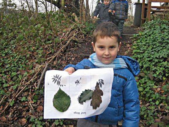 Boy showing leaf work done at the forest school, Camden Community Nurseries