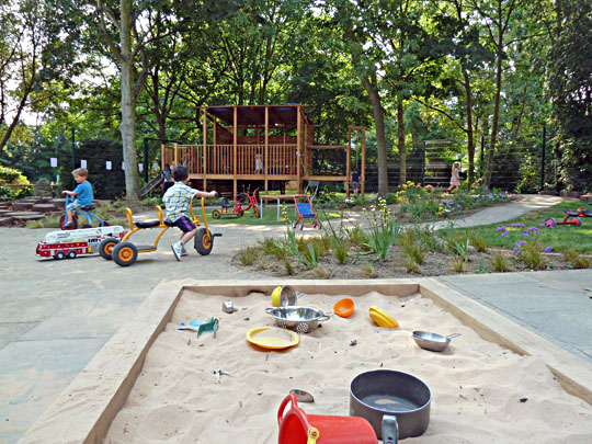 Sandpit and climbing frame in the garden at Montpelier Community Nursery,  one of Camden Community Nurseries' three facilities in north London